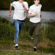 Stock Photo: Young friends jogging