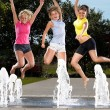 Jumping in a fountain — Stock Photo