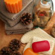 Soaps, towels, candles and pine cones — Stock Photo