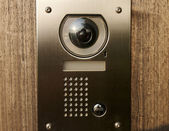 Door intercom with camera on wood — Stock Photo