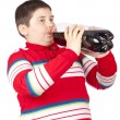 Stock Photo: A young men drinking soda from a plastic bottle