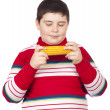 Stock Photo: Boy looking at a boiled corn