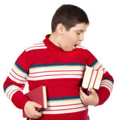 Child holding books — Stock Photo