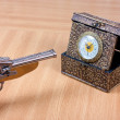 Stock Photo: Clock and gun