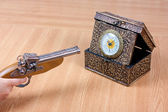 Clock and gun — Stock Photo