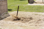 Flying sand as the Horseshoe ringer is made. — Stock Photo