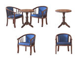 Table and chairs with blue upholstery — Stockfoto