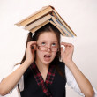 Royalty-Free Stock Photo: Girl with a big stack of books