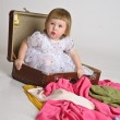 Little girl and an old suitcase — Stock Photo