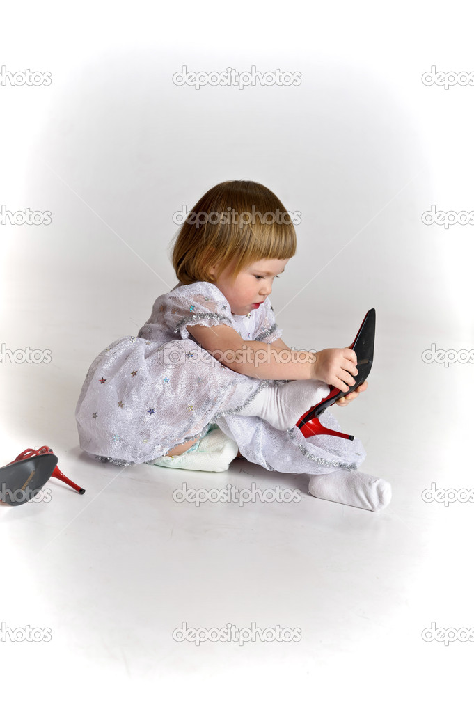 Girl dressed big shoes — Stock Photo #5490945