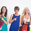 Shopping girls with credit cards - 图库照片