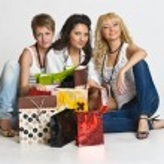 Three beautiful girls are shopping — Stock Photo #5624084