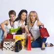Three beautiful girls are shopping — Stock Photo