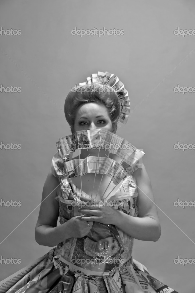 Girl in a dress from newspapers — Stock Photo #5624797