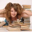 Young student woman with lots of books studying for exams — Stock Photo #5706354