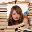 Stock Photo: Young girl with books
