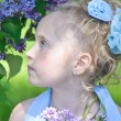 Girl with lilac - Stock Photo