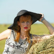 Stock Photo: Girl in wide-brimmed hat
