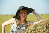 Girl in wide-brimmed hat — Stock Photo