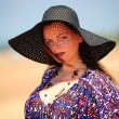 Girl in wide-brimmed hat - Stock Photo