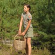 Girl with a basket to collect mushrooms IN THE FOREST — Stock Photo #6496113