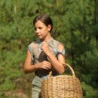 Girl with a basket to collect mushrooms IN THE FOREST — Stock Photo #6496131