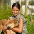 Stock Photo: Girl and puppy