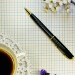 A romantic background. sheet of paper, pen, coffee, flowers — Stock Photo