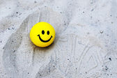 Yellow small child a ball. Ball with a smile. — Stock Photo