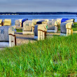 Hooded beach chairs at the beach - Stock Photo