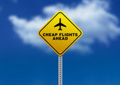 Cheap Flights Ahead Road Sign — Stock Photo