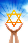Hand holding a Jewish Star — Stock Photo