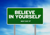 Green Road Sign - Believe in yourself! — Stock Photo