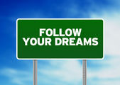 Green Road Sign - Follow Your Dreams — Stock Photo