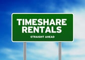 Green Road Sign - Timeshare Rentals — Stock Photo