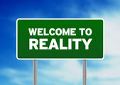 Green Road Sign - Welcome to Reality — Stock Photo