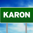 Green Road Sign - Karon, Thailand - Stock Photo