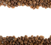 Aromatic coffee beans on white background — Stock Photo