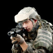 Soldier with a rifle isolated on black background — Stock Photo #5960157