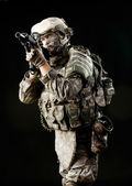 Soldier with a rifle isolated on black background — Stock Photo