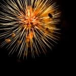 A burst of orange fireworks against a night sky. — Stock Photo #5466631