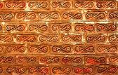 Tegelvägg med infinity fodrad figur — Stockfoto