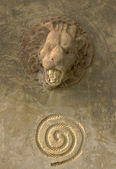 Lion statue head with round string mark — Stock Photo