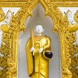 Monk sculpture in Thai style art frame — Stock Photo
