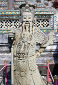 Ancient lord stone statue in Thailand Buddha temple — Stock Photo