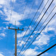 Power lines on the blue sky with cloudy background — Stock Photo #6303410