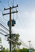 Transformer and electric line in rural of Thailand — Stock Photo