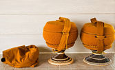 Monk's alms bowl with crochet overlay and kitbag — Stock Photo