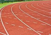 Curva de una pista de atletismo — Foto de Stock