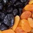 Dried apricots and prunes — Stock Photo